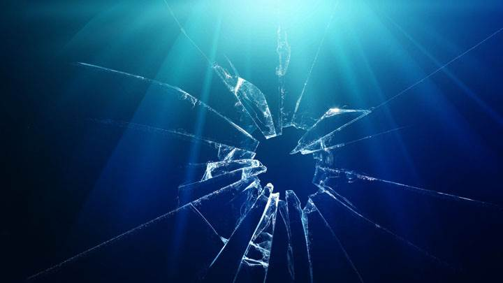 Shattered Glass And Blue Background